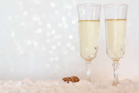 Glasses of champagne on bright background with bokeh effect with copy space Standard-Bild
