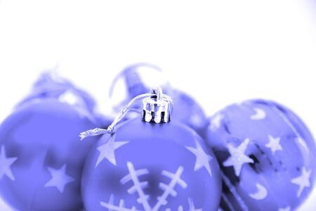 Blue christmas baubles over a white background photo