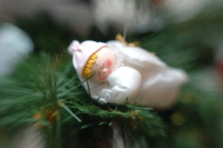 Sleeping angel toy on christmas tree (lensbaby shot) photo
