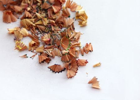 Colorful pencil shavings isolated in white background photo