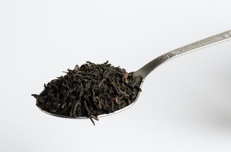 fermenting: Loose black tea heaped on tea spoon