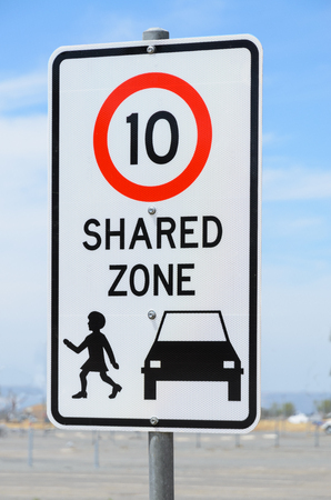 shared: Shared zone speed limit warning road sign Stock Photo