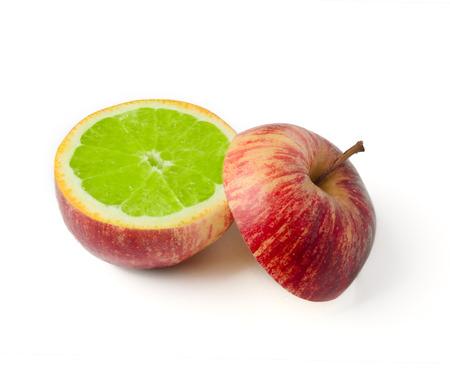 apple gmo: Apple cut with orange inside GMO concept genetically modified fruit