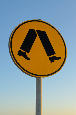 crossing legs: Pedestrian crossing Australian warning road sign walking legs