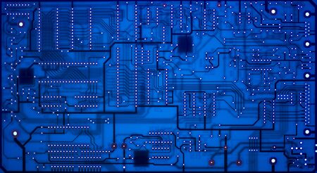 electronic circuit: Abstract circuit board lit blue from behind