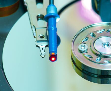 Optic Fiber reflecting on Hard Disk Drive macro photo