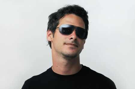 headshoot: Portrait of trendy young male model wearing sunglasses