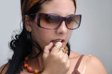 Portrait of trendy hispanic model with sunglasses