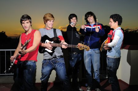 Portrait of trendy group of young musicians having fun with their instruments Stock Photo - 3177480