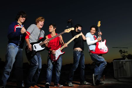 Group of trendy teenagers with musical instruments photo