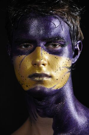 bodypaint: Portrait of young handsome male model wearing artistic bodypaint drawing