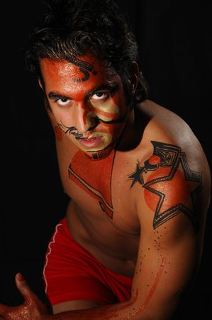 Portrait of young handsome male model wearing artistic bodypaint drawing photo