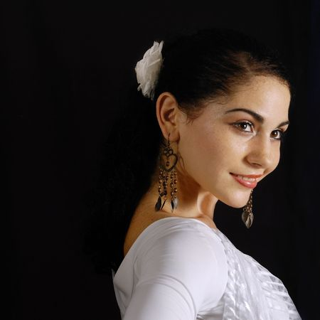 Portrait of hispanic flamenco dancer woman isolated on black with happy smile Stock Photo