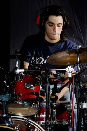Portrait of young musician playing the drums Stock Photo - 3177725