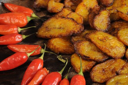 detail of typical cuban dish with red peppers and fried banana photo