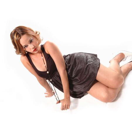 Portrait of young woman reclining in the floor - isolated Stock Photo - 3250354