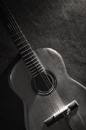 black wood texture: Black and white still life with old acoustic guitar Stock Photo