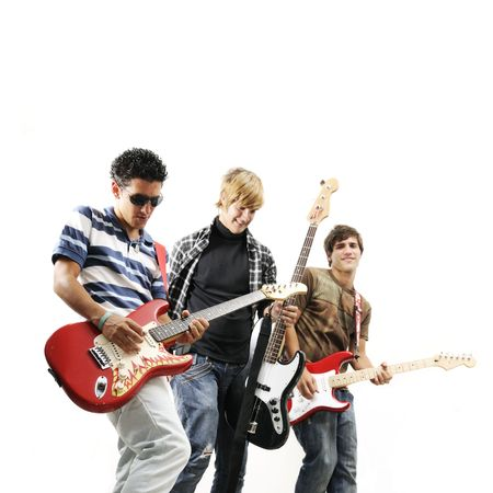 teens playing: Young trendy team playing electric bass and guitars - isolated Stock Photo