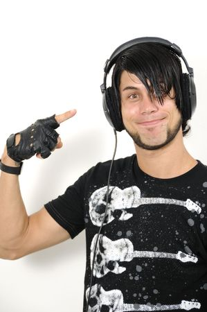 Portrait of young trendy hispanic male pointing to headphones - isolated photo