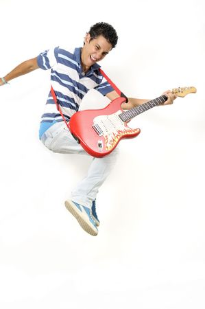 a guitarist boy playing guitar: Portrait of trendy teen jumping with electric guitar - isolated