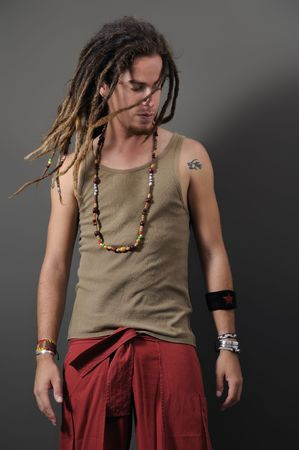 Portrait of young funky male with long dreadlocks Stock Photo