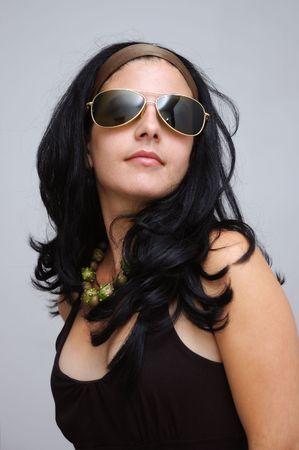 Portrait of trendy hispanic female wearing fashion sunglasses photo
