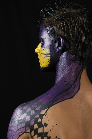 Portrait of young model wearing artistic bodypaint drawing photo