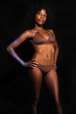 african bikini: Portrait of young fashionable woman wearing bikini - isolated on black