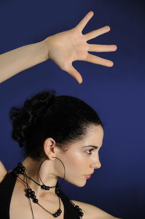 Portrait of young hispanic female model with open hand  Stock Photo