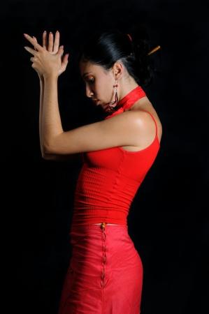 spanish style: Portrait of hispanic flamenco dancer woman isolated on black