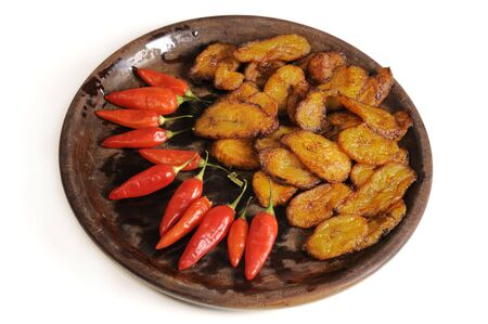 Typical cuban food on wooden dish isolated - fried babana and chili peppers Stock Photo - 3307113