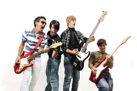 Portrait of young musical band playing with instruments - isolated Imagens