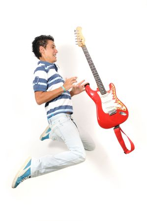 Portrait of crazy teen jumping with electric guitar - isolated photo