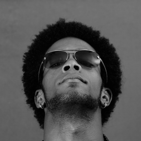 cool guy: Portrait of young african man wearing sunglasses in black and white Stock Photo