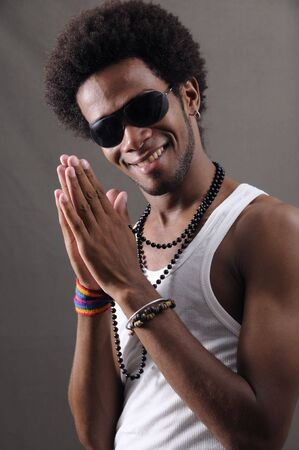 Portrait of young trendy african american male with happy expression photo