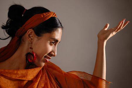 profile: Portrait of hispanic dancer female with orange veil