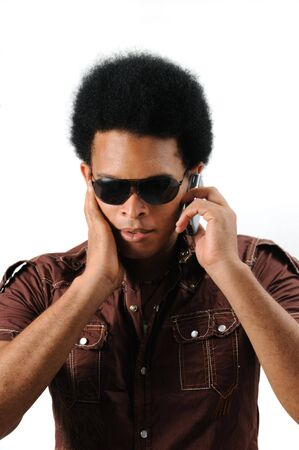 Portrait of young trendy african male using a cell phose - isolated Stock Photo - 3469305
