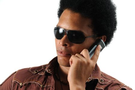 Portrait of young trendy african man using a cell phone - isolated Stock Photo - 3469363