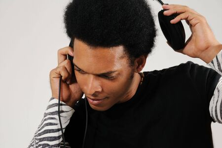 Portrait of young trendy latino man with headphones Stock Photo