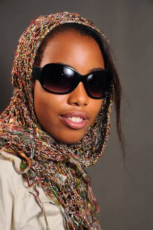 Portrait of yong trendy african female model with sunglasses photo