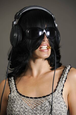 Portrait of young bizarre woman with headphones photo