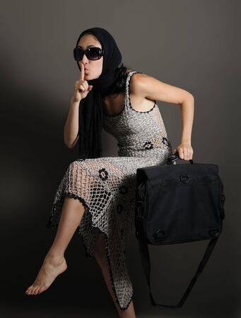 Portrait of young fashion woman holding portfolio Stock Photo - 3469311