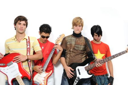 Portrait of young trendy teenager group posing with musical intruments Stock Photo - 3484489