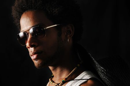 Portrait of young trendy african male with sunglasses photo