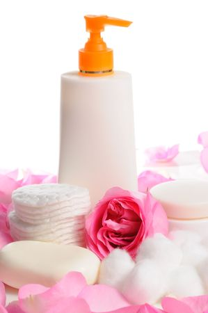 Natural beauty products with rose petals isolated over\ white