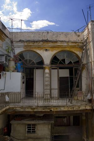 Detail of typical cuban building with shabby interior