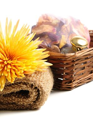 Basket with natural spa elements and chrysanthemum – isolated on white Stock Photo