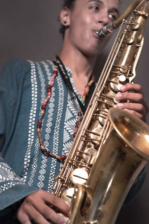 Portrait of young man playing saxophone
