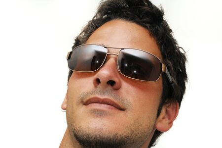 look latino: Portrait of young trendy male model wearing sunglasses isolated