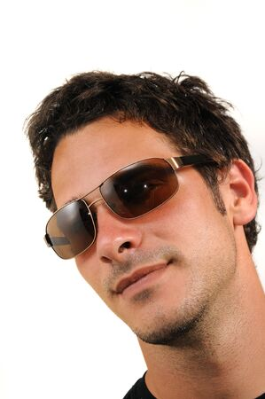 Portrait of young handsome hispanic man wearing sunglasses photo